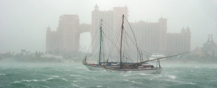 Haitian sloops rock around in rough seas in front of the Atlantis Paradise Island resort Friday, Sept. 3, 2004 as Hurricane Frances passes close to the island of New Providence in the Bahamas. A group of Haitians were forced to flee their sailing vessel in the harbor and take refuge on land after encountering problems on the boat. (AP Photo/Tim Aylen)