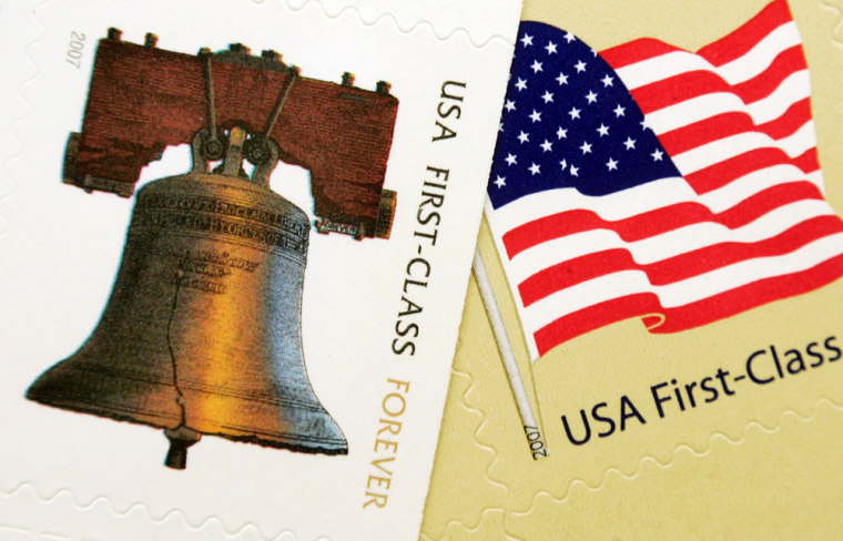 """The """"forever"""" stamp, left, that features a likeness of the Liberty Bell, appears next to the new 41 cent first-class flag stamp."""