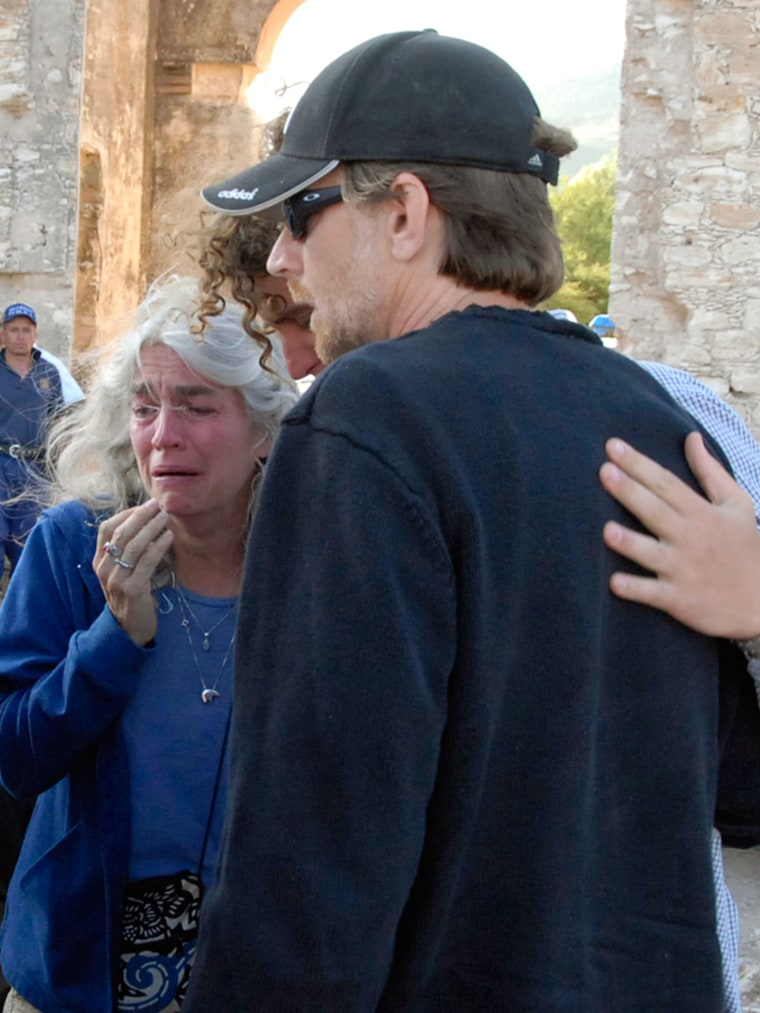 Sue Paterson, left; Christopher Crane, right, and an unidentified person, center, grieve in San Luis de la Paz, Mexico, Saturday, near an abandoned mine where Paterson's and Crane's son 16-year-oldTaylor Crane fellto his death on Friday.