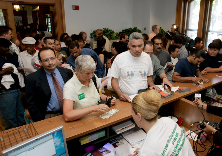 ID card applicants crowd an office atCity Hall in New Haven, Conn., on Tuesday.