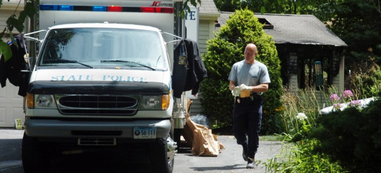 A member of the Connecticut state police prepares to enter the Petit home in Cheshire Conn., on Tuesday July 24, 2007. The home was the scene of a home invasion in which three members of the Petit family were killed after intruders entered their home early Monday. (AP Photo/Fred Beckham)