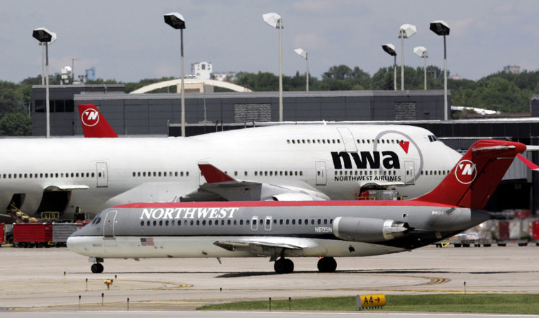 Northwest Airline planes taxi around the Minneapolis St. Paul International Airport