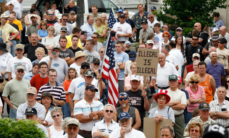 A Hazleton crowd rallies in June to support Mayor Lou Barletta, who passed the Illegal Immigration Relief Act. The law would have imposed fines on landlords who rent to illegal immigrants and denied business permits to companies that give them jobs.
