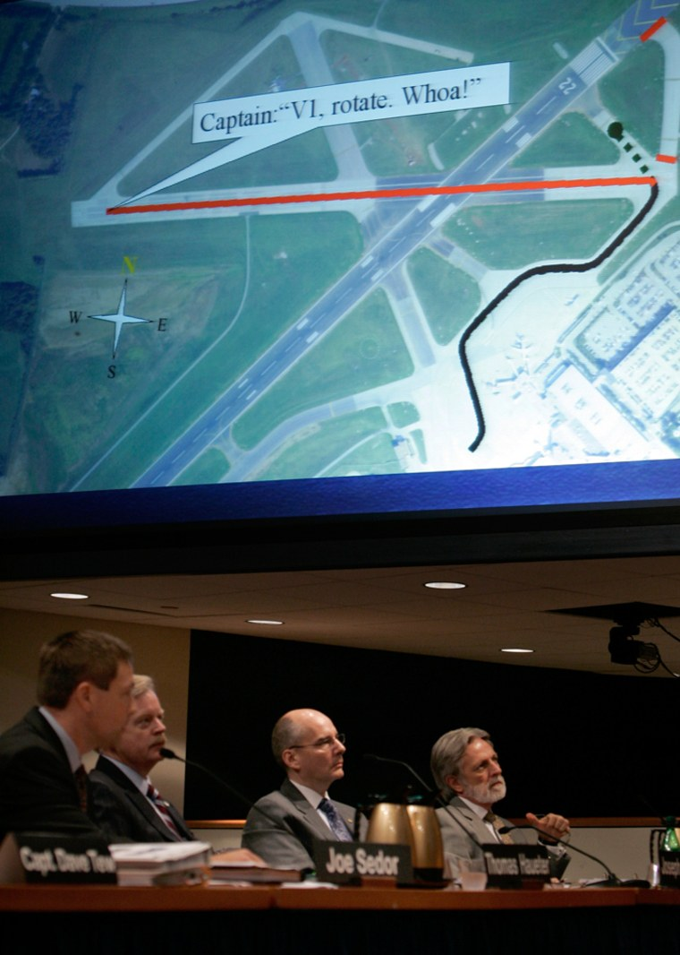 Members of the National Safety Transportation Boardreview an image that showsa Kentuckyplane was on the wrong runway before its fatal crash.
