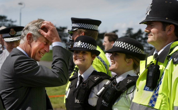Britain's Prince Charles meets police officers who assisted during the recent flooding in Cheltenham, central England