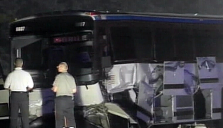 Emergency personnel arrive at the scene of Friday morning's Greyhound bus-SUV crash in Alabama.