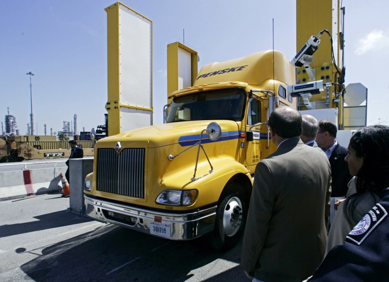A cargo truck goes through a newradiation-scanning machine during a demonstration at the Long Beach Port in Long Beach, Calif., on July 20.