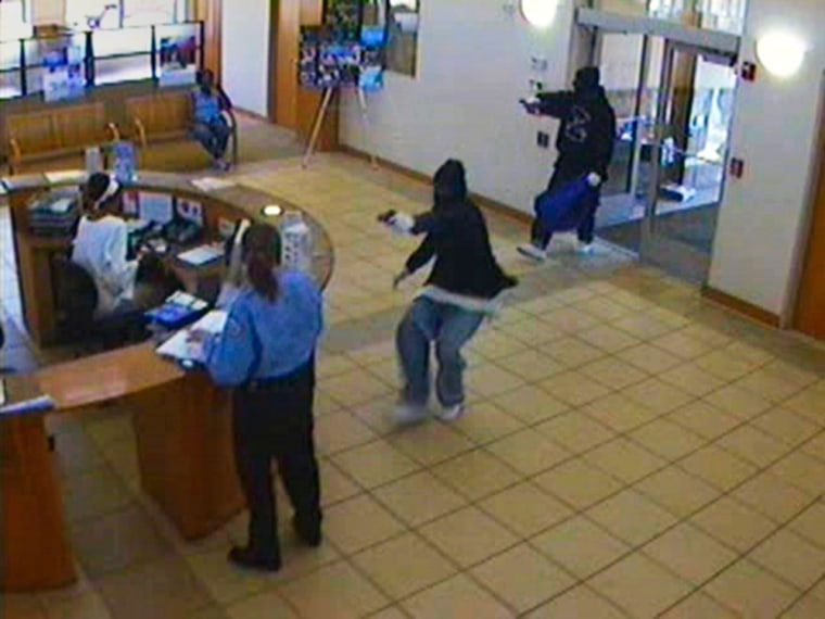 Masked gunmen stormed the Illinois Service Federal Savings and Loan in Chicago during a robbery on May 22,killing a teller and wounding two others during an exchange of gunfire with a security guard.
