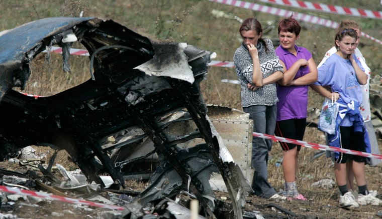 Local residents view the wreckage of a Tupolev Tu-154 that crashed near the Ukrainian city of Donetsk last year, killing all 170 people on board. Russian airlines had the world's worst air safety record last year.