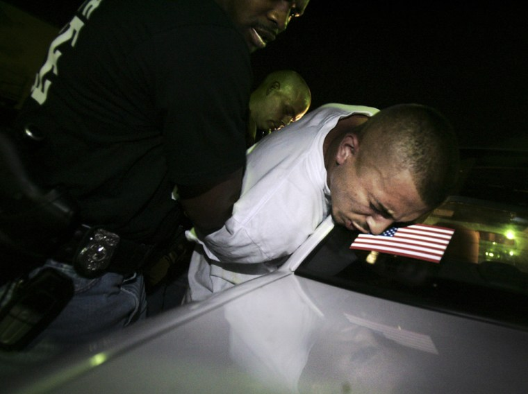 A suspected gang member is arrested by the Fort Wort Police Gang Unit in Fort Worth, Texas, on July 4.
