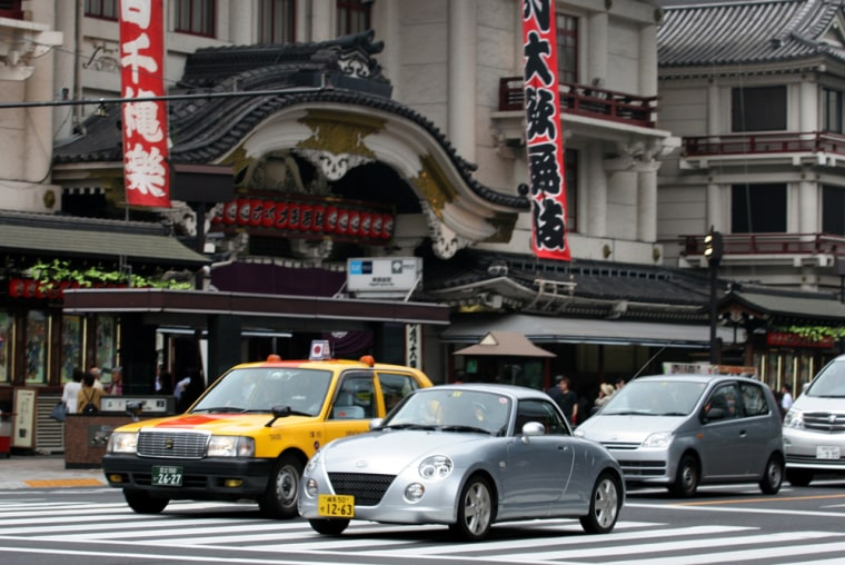 """Known as """"kei,"""" or light, cars in Japanese, minis are limited to an engine size of up to 660 cubic centimeters — less than half the size of a Honda Civic — and restricted by law to being no bigger than 11.2 feet long and 5 feet wide."""