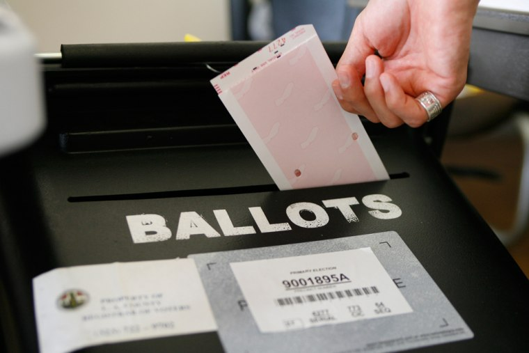 A paper ballot is placed in a ballot box in this file photo from the 2006 California Primary Election.