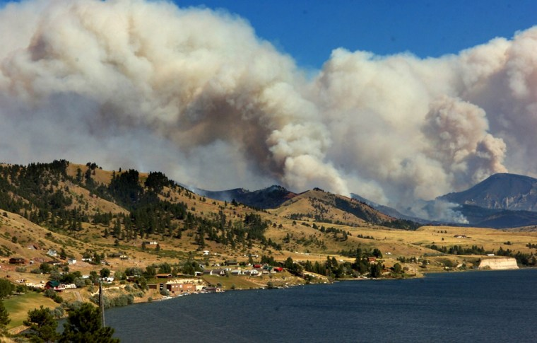 A wildfire burns nearHolter Lake, Mont., on Tuesday. Dozens of homeowners and campers around the lake were told to evacuate.