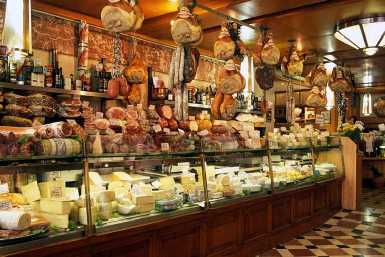 ARXYD0 Italy Emilia Romagna Bologna via Caprarie Tamburini interior gastronomia food cheese salami prosciutto