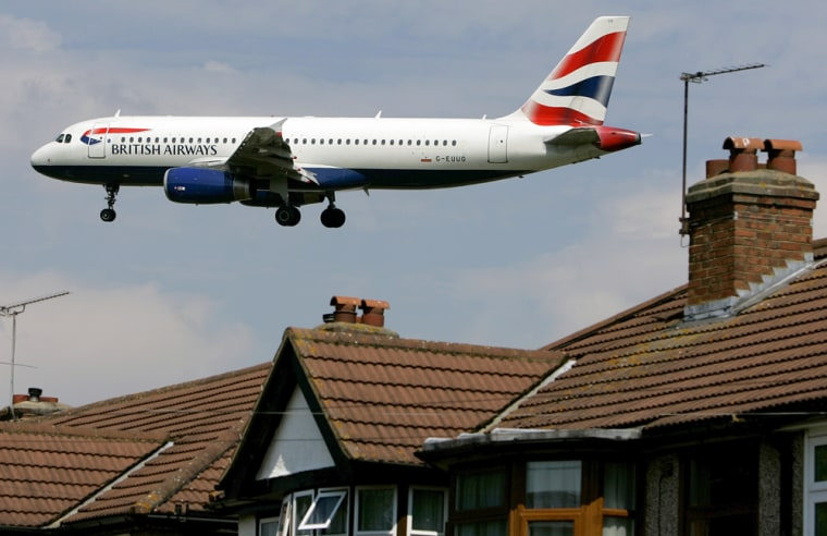 A British Airways plane flies over residential rooftops as it comes in to land at Heathrow Airport in London. With fears mounting of chaos when the city hosts the Olympics in 2012, government officials and business heads are calling for urgent improvements at the world's third-busiest airport.