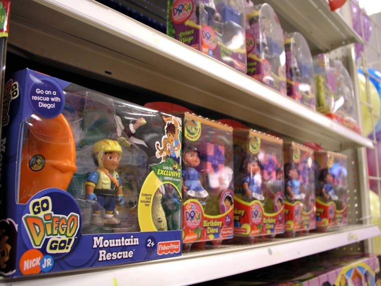 Fisher-Price toys subject to recall including 'Go Diego Go Mountain Rescue,' and 'Birthday Dora,' right, are seen on a store shelf late Wednesday in Alexandria, Va.