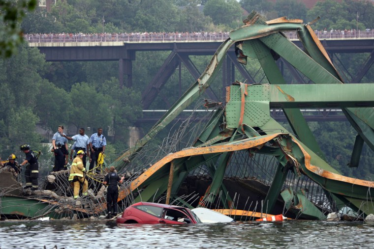 Emergency personnel work at the scene of a bridge collapse Wednesday in Minneapolis.