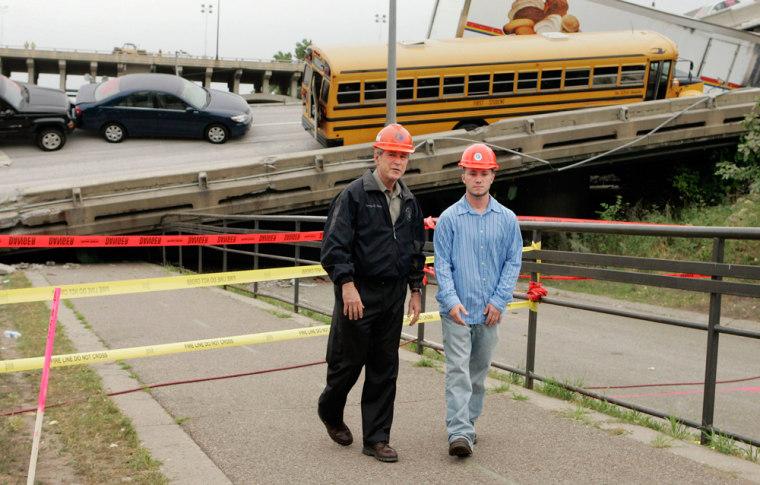 U.S. President George W. Bush tours the I-35W bridge collapse site in Minneapolis