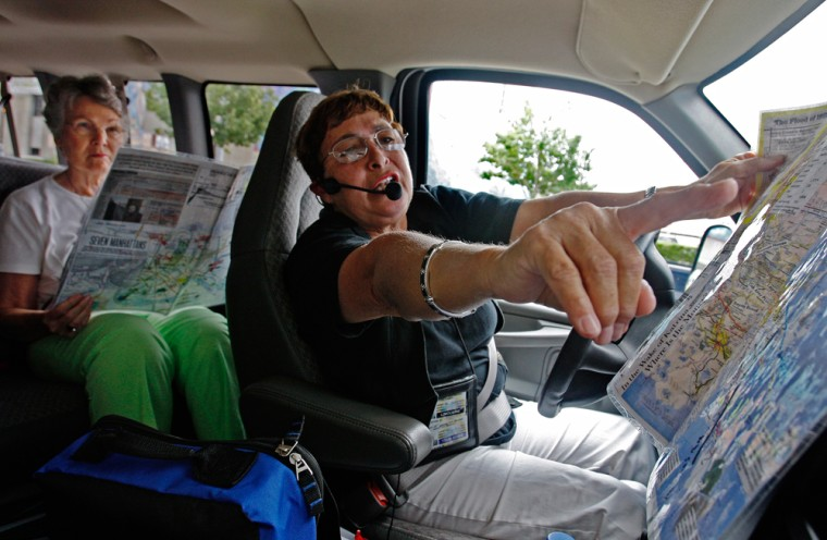 Tour guide Rose Scott, hands out maps as visual guides to the tourists in her van, as she explains the area they will cover in the 3 1/2 hour tour of the devastation caused by Hurricane Katrina and broken levees which hit on Aug. 29, 2005, in New Orleans.