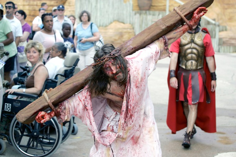 Les Cheveldayoff portrays Jesus during a performance of the Crucifixion, as a somber audience watches at the Holy Land Experience, a Christian-themed attraction in Orlando, Fla., on July 13.