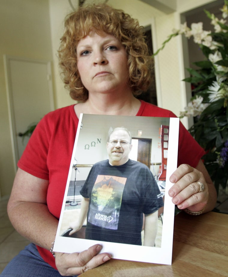 Kathleen Wright holds an image of her brother, Cecil Sinclair, who recently passed away, on Friday, Aug. 10. Relatives of Sinclair, a gay Navy veteran, say they are upset that a megachurch canceled his memorial service 24 hours before it was to start.