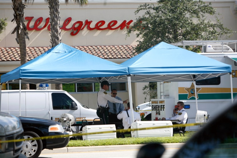 A sheriff's deputy looking for stolen vehicles at a drug store was killed early Friday.