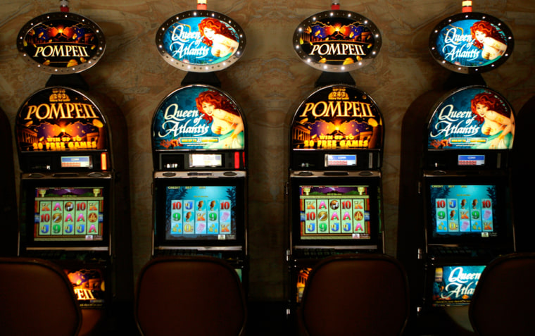 New slot machines are seen at the MotorCity Casino in Detroit. The city is hoping to position itself as a true gambling-based destination for tourists. The city's three casinos are spending $1.5 billion to build sleek new hotels, expand their facilities, and inject some glitz into the gritty Motown landscape.