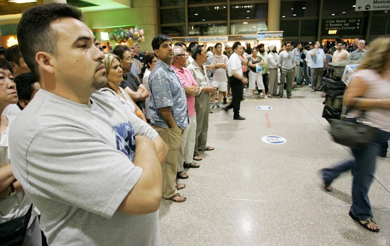 Salvador Guerrero waits for his wife to exit customs at LAX after a computer failure by customs and border protection left about 17,000 passengers stranded on airplanes and in terminals on Saturday.