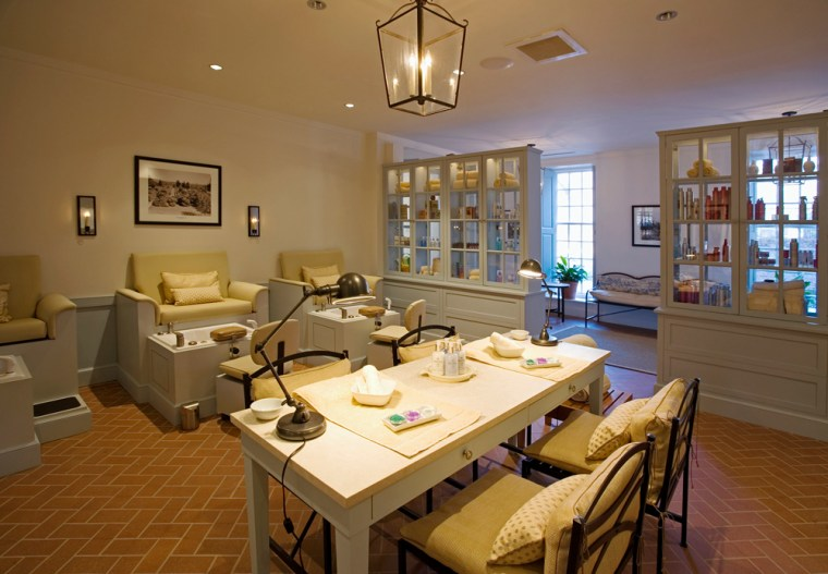 At themanicure table in the center of the nail salon at The Spa of Colonial Williamsburg in Virginia, two friends can receive nail treatments at the same time, while ergonomic pedicure stations allow guests to relax and technicians to pamper guests' feet without bending.