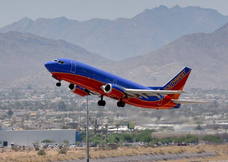 A Southwest Airlines jet takes off from Sky Harbor International Airport in Phoenix. The discount carrier is on pace to unseat American Airlines this year as the world's biggest airline, measured by passenger traffic.