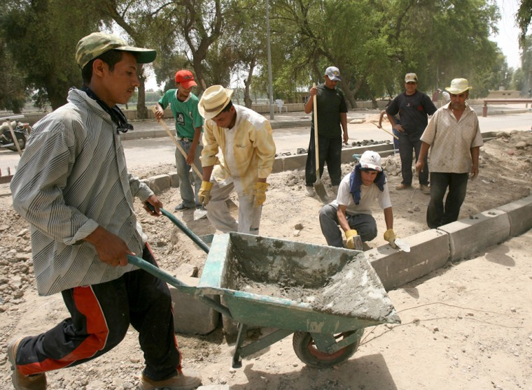 Workers rebuild amile-long section of the Abu Nawas Street, whichis scheduled to reopen to the public Sept. 1.