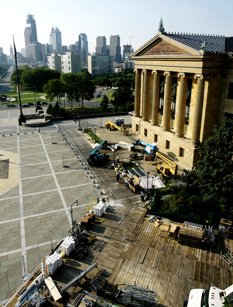 The Philadelphia skyline looms behind the Philadelphia Museum of Art. The museum is undergoing a decade-long plan to renovate existing facilities, create vast new display spaces and, ultimately, allow visitors to see more art in rooms better suited for viewing.