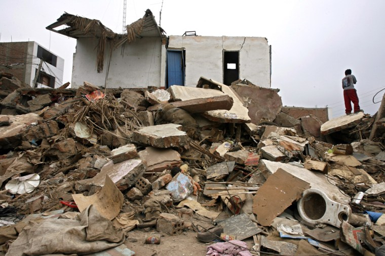 A boysurveys damage on Monday in Pisco, Peru, where last week's earthquake destroyed more than 85 percent of the homes.