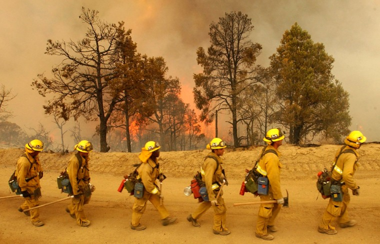 A Ventura County fire crew backs down a bit as flames from the Zaca fire approach a fire break north of Ojai, Calif., on Monday.