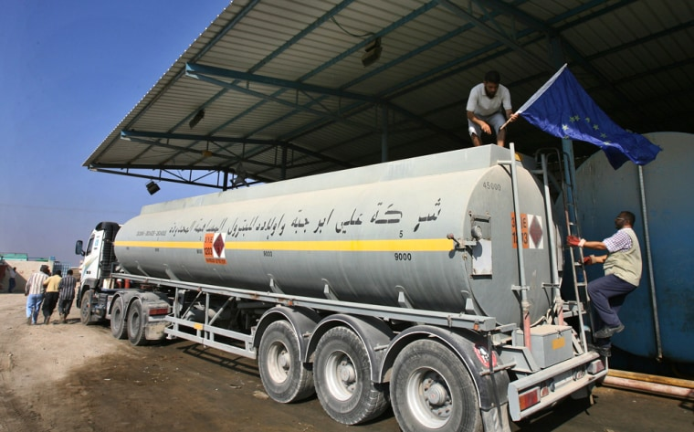 A European Union flag is placed on a fuel tanker on the Palestinian side of a border crossing from Israel into the Gaza Strip on Wednesday, as EU fuel shipments to the Mediterranean coastal strip resumed.