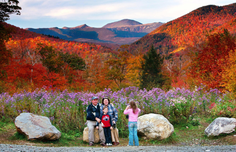 Wildflowers, fall foliage and 6,288-foot Mt. Washington serve as a backdrop for Jim and Kathleen Gannon and their son James as their daughter Katarina snaps a picture at Crawford Notch State Park in New Hampshire last fall.