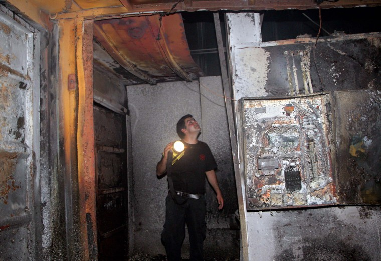 An Israeli man examines the damage caused by fire to the only crematorium in Israel.