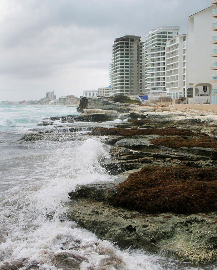 Portion of the beach in Cancun is seen after it's sand was washed away by hurricane Dean