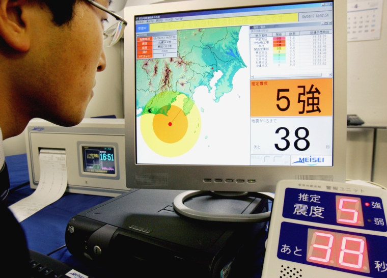Akihiko Sawamura, a field engineer of Meisei Electric Co. in Yokohama, looks at a monitor screen indicating that a strong level 5 earthquake will hit Tokyo in 38 seconds, duringa simulated demonstration of his company's earthquake information system.