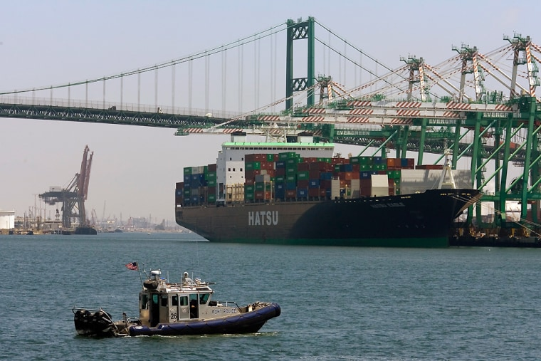 A patrol boat guards the Port of Los Angeles in July. A new law sets a five-year deadline for inspecting 100 percent of U.S.-bound ships, but acknowledges the technology may not be ready to do so.