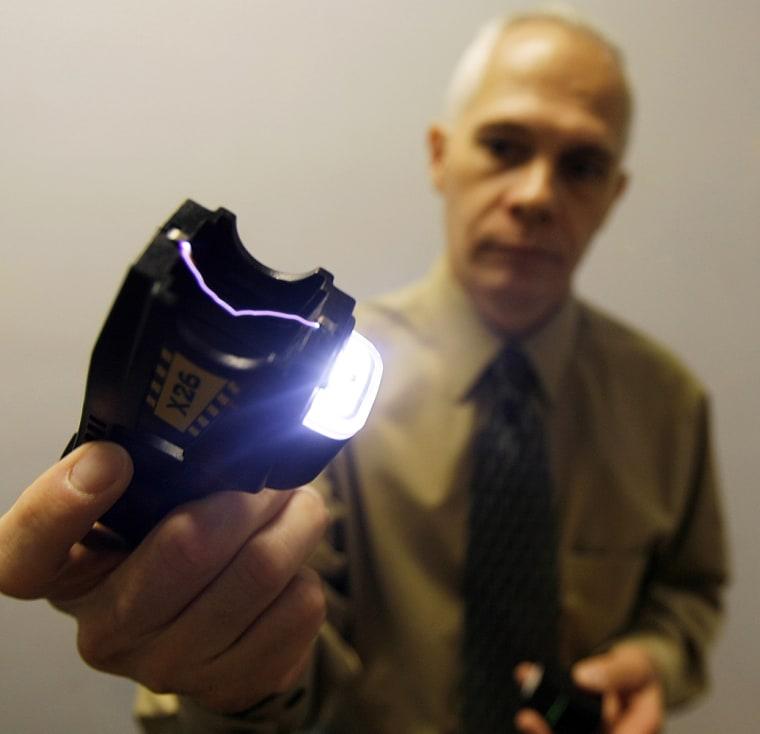 Police Chief John Martin demonstrates a Taser in Brattleboro, Vt., Thursday, Aug. 16.
