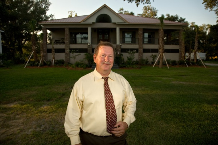 Aulton Vann Jr. stands in front of his new beachfront home in Pascagoula, Miss.