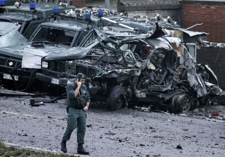 A Spanish civil guard walks at the scene of a car bombing outside a police station in the Basque city of Durango, northern Spain, on Friday.