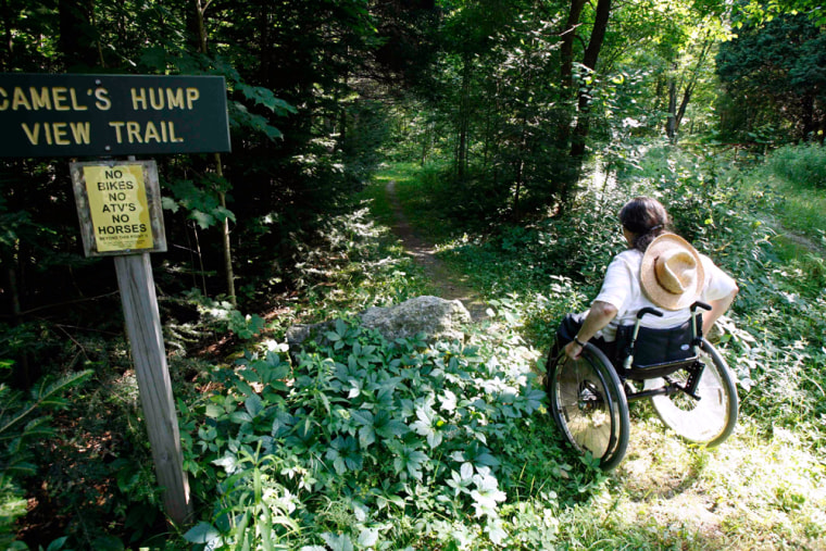 Deborah Lisi-Baker starts her wheelchair up the View Trail at Camel's Hump in Duxbury, Vt. The Camel's Hump View Trail is part of a nationwide push in the past 20 years to make more of the great outdoors accessible to people with disabilities.