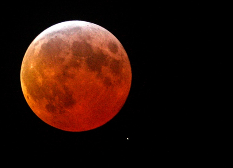 A shadow falls on the moon during a lunar eclipse seen from Vodno mountain south of Macedonia's capital Skopje