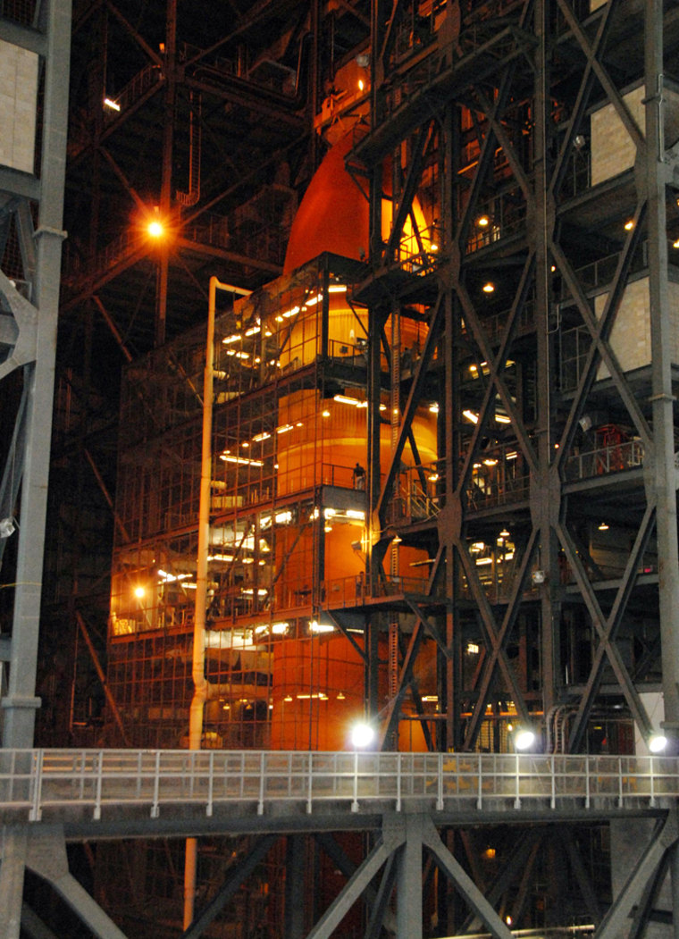 The fuel tank destined for the shuttle Discovery's launch in October sits in NASA's Vehicle Assembly Building. Tests have revealed cracks in the insulation around the tank's fuel-line brackets, officials say.