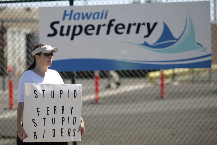 Protester Bonnie Bias of Maui stands in front of the terminal entrance to the Hawaii Superferry in Wailuku, Maui, on Sunday.
