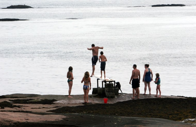 Residents of Money Island take advantage of a diving board in the Thimble Islands off the coast of Branford, Conn. The island chain, within a three-mile radius of Stony Creek, has long attracted the rich and reclusive, the famous and infamous, from President William Howard Taft to P.T. Barnum's circus star Tom Thumb to cartoonist Gary Trudeau and his wife, television journalist Jane Pauley.