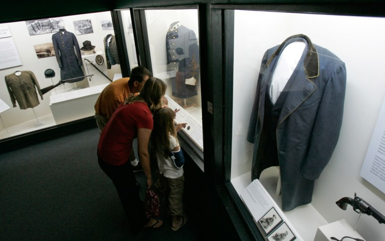 A family looks at one of the displays at the Museum of the Confederacy in Richmond, Va. The museum bills itself as home to the world's largest collection of Confederate artifacts.