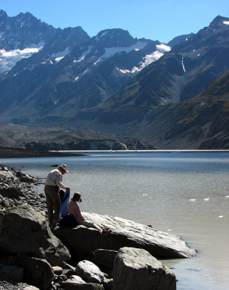 Walkers take a break at Hooker Lake, in Mount Cook National Park, on New Zealand's South Island. Mount Cook is New Zealand's highest mountain and is visible from locations on the west coast, but to get close to it requires a detour, from the eastern side of the South Island.